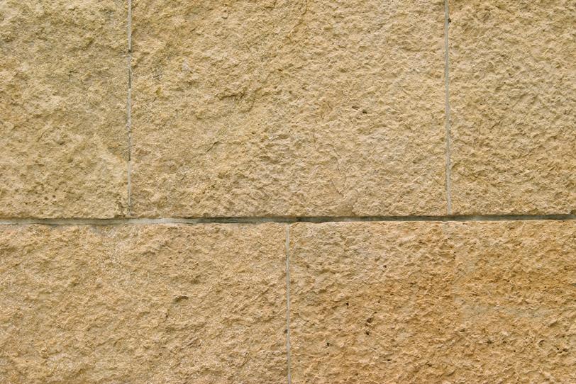 薄茶色の石壁のテクスチャの写真画像