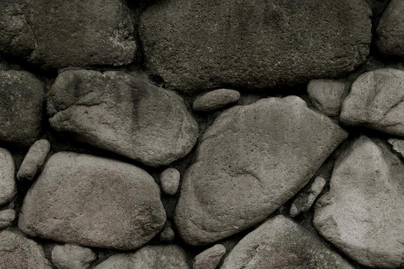 素朴な石の壁の写真画像