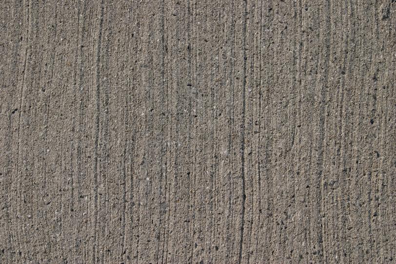 流れるような筋の入ったモルタルの写真画像
