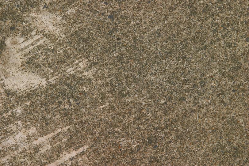 沢山の砂利の入ったコンクリートの質感の写真画像