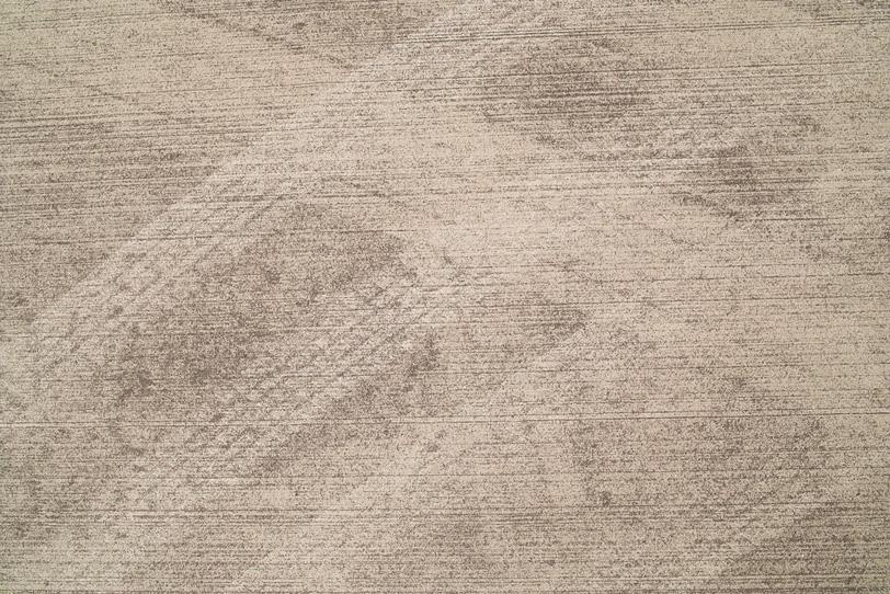 茶色く汚れたコンクリートの写真画像