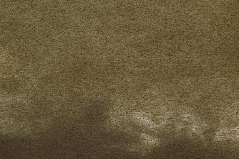 茶色い染料の滲みがある紙の写真画像