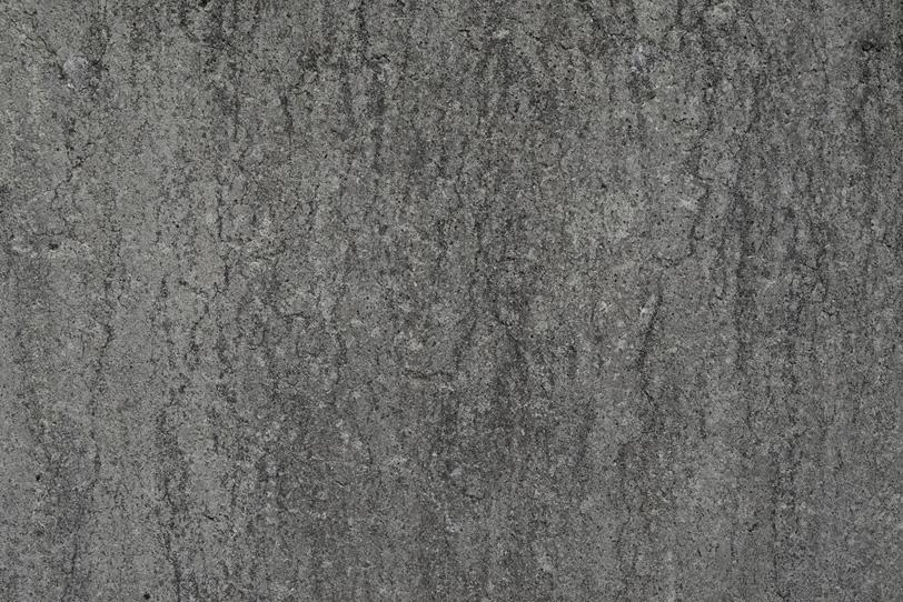 雨ジミのあるコンクリートの写真画像