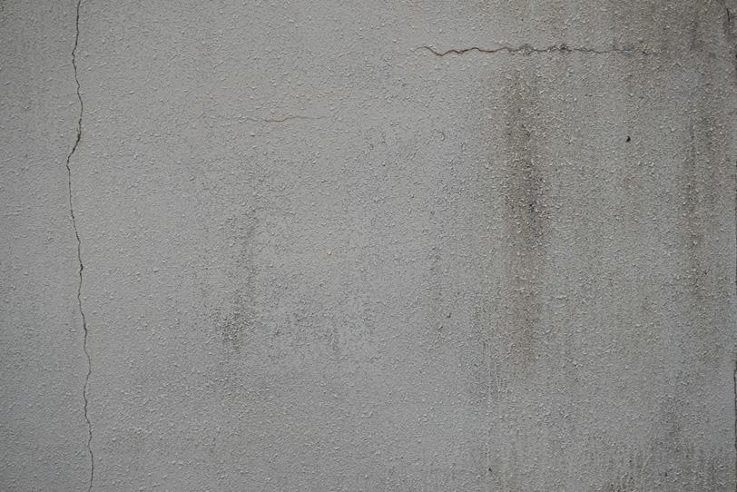 ひび割れた壁のテクスチャの写真画像