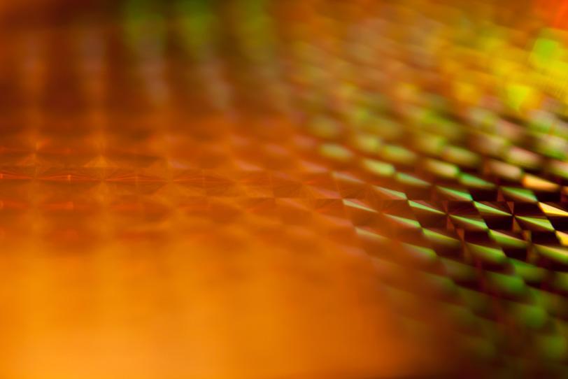 オレンジと黄緑色の滲む光の写真画像