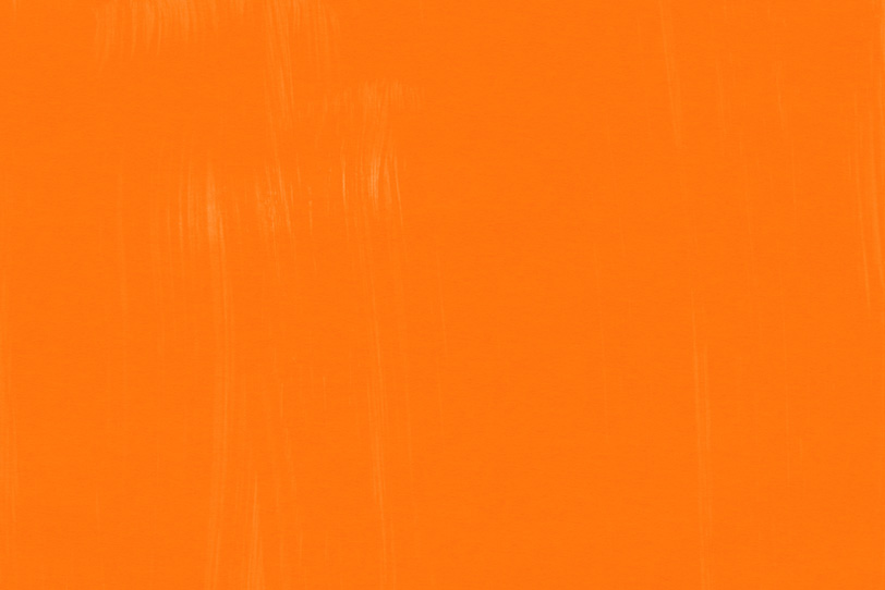 オレンジの絵具で描いたシンプルな壁紙