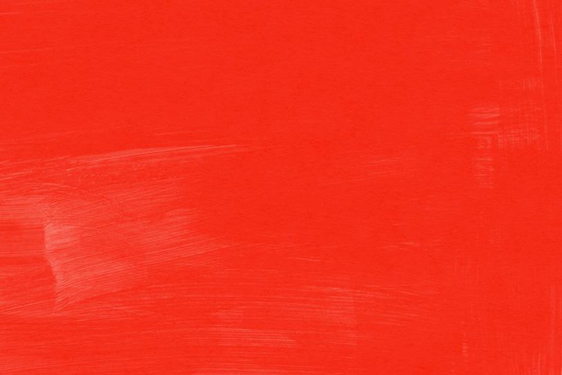 赤の絵具を塗ったシンプルな背景