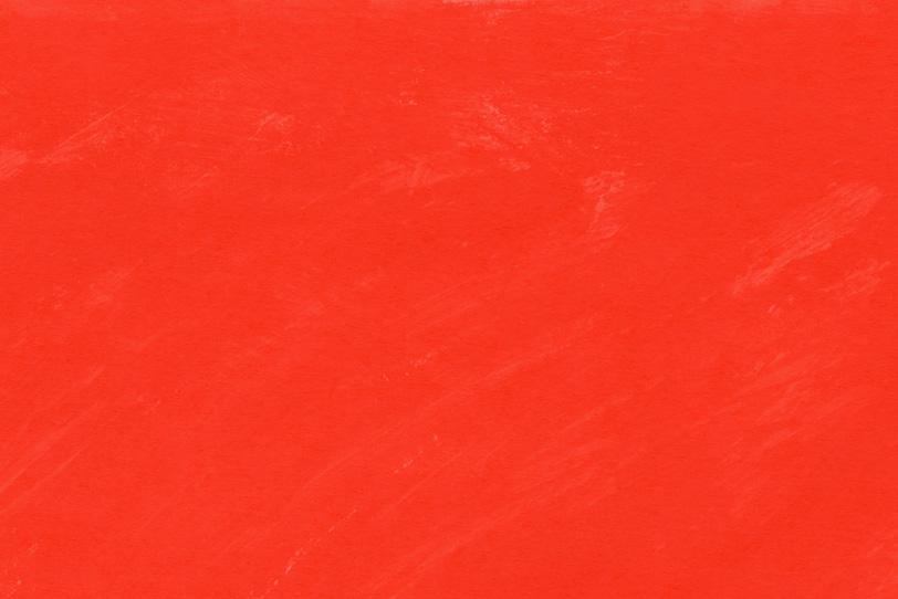 赤色の水彩絵具を塗ったテクスチャ