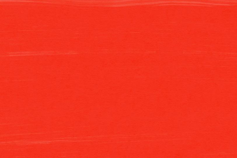 赤色の絵具がきれいな無地背景