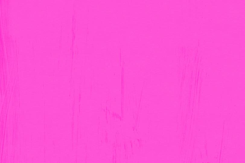ピンク色の無地壁紙のテクスチャ