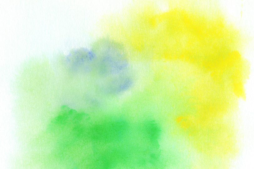 紙に滲む黄色と緑色の水彩の写真画像