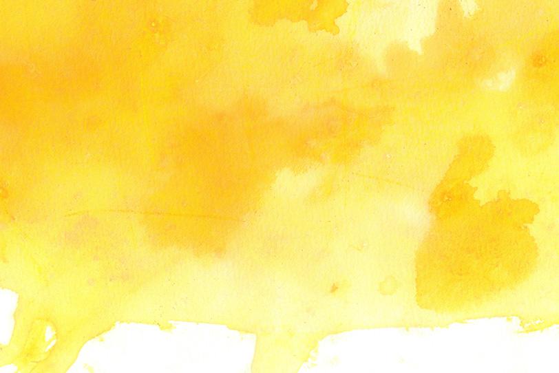 濃淡のあるクロムイエローの水彩の写真画像