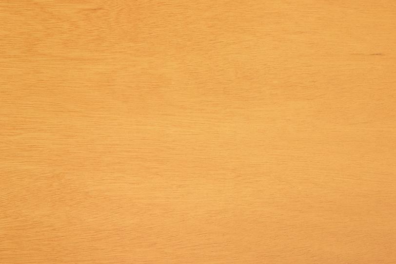 浅い木目が残る黄色い木板の写真画像