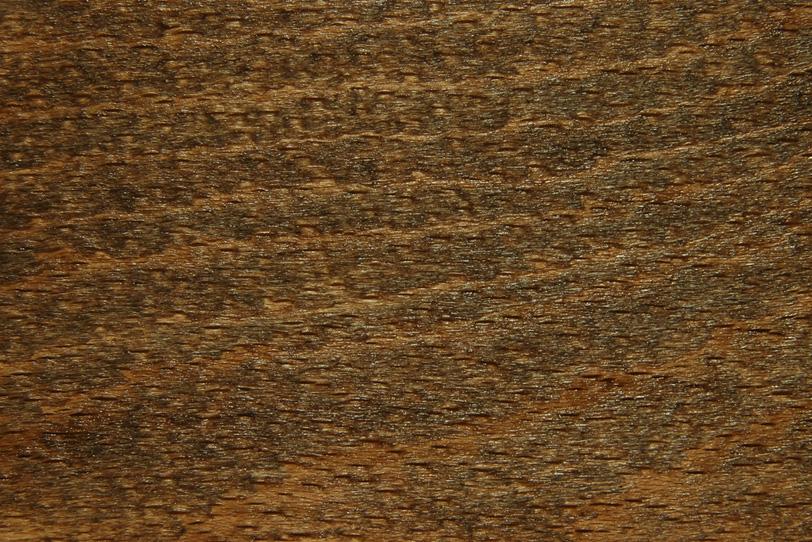 光沢のある黒い木肌の写真画像
