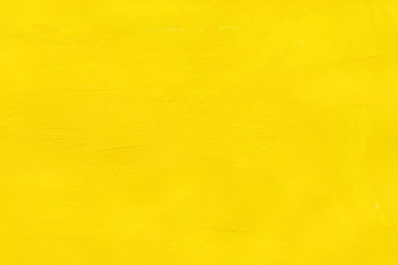 黄色の無地のテクスチャ壁紙