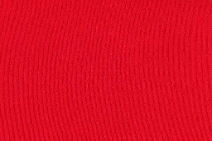 赤いスウェット生地のテクスチャ