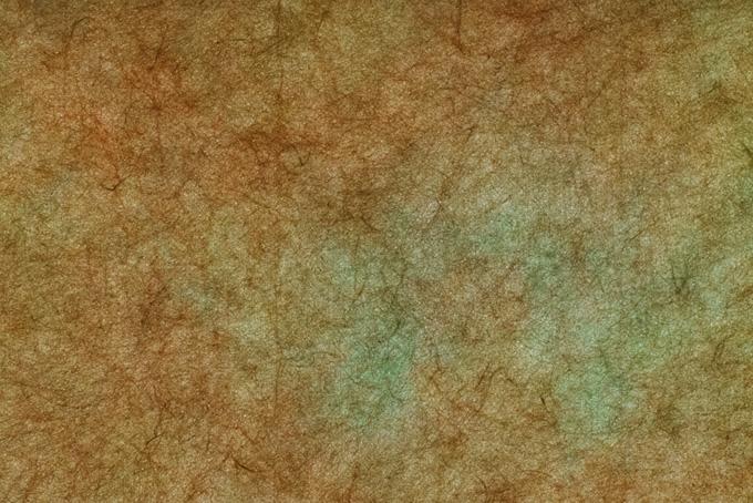 茶と緑がにじむ絞り染の和紙