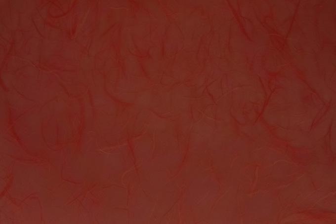楮の筋のある弁柄色の和紙