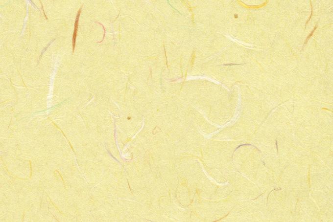 色付き楮が入った薄黄色の和紙の背景