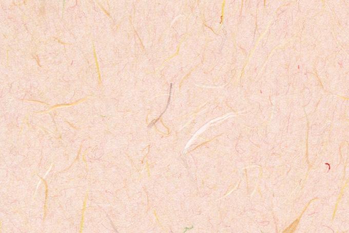柔らかな雰囲気の赤香色の和紙の背景