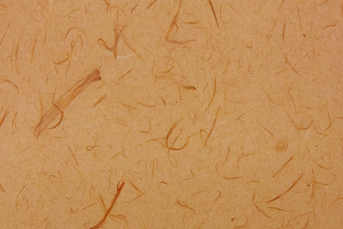 黄みの深い赤褐色の和紙背景
