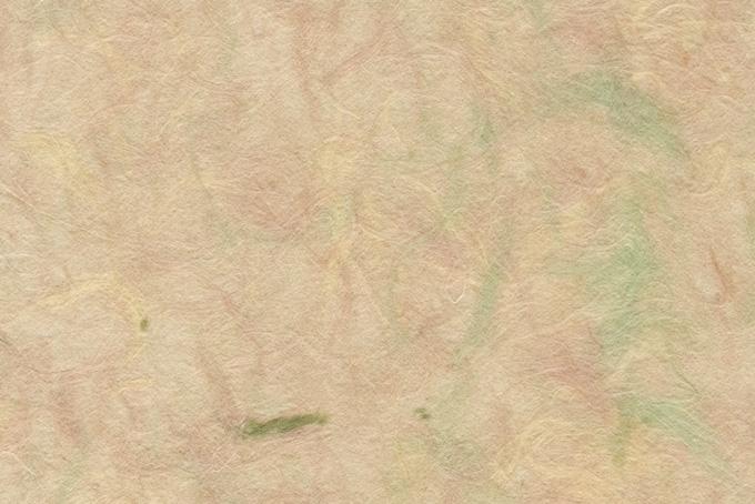 色付き楮が透ける肌色の和紙の背景