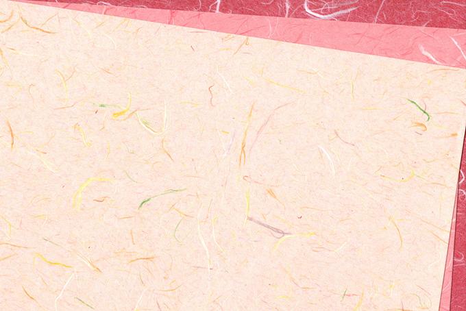 春らしいピンク系の和紙背景のテクスチャ