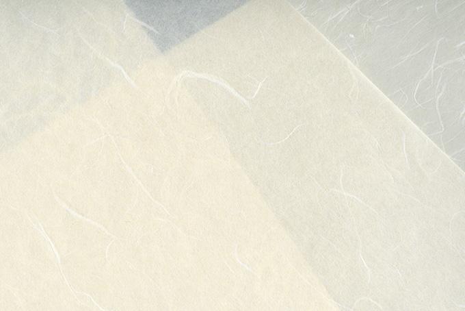 白色と灰色の重なった和紙のテクスチャ
