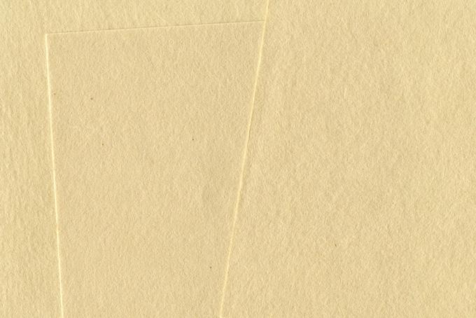 素朴な生成り色の和紙背景のテクスチャ