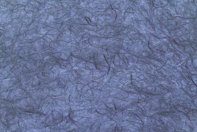 楮のテクスチャが目を引く紅碧色和紙の画像素材