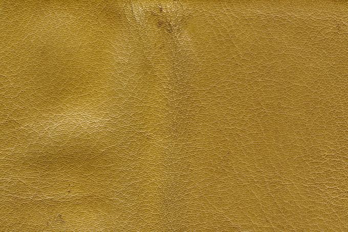 黄色に染められた革のテクスチャ