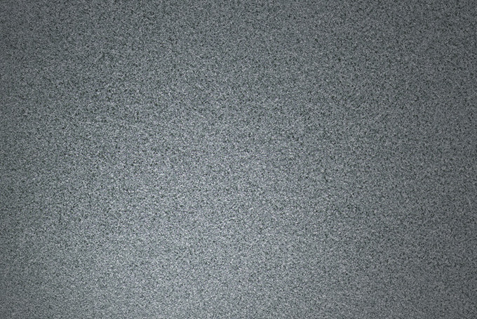 鈍く光るガンメタリックの背景(金属 テクスチャのフリー画像)