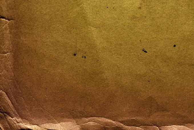 傷とシワがあるセピア色の古紙