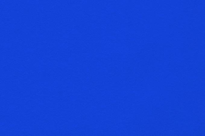 滑らかな表面の紺色の紙
