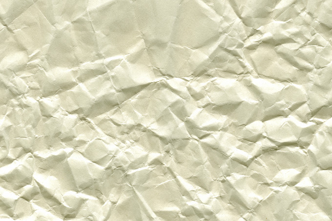 硬いシワが無数についた紙の素材(紙 テクスチャのフリー画像)