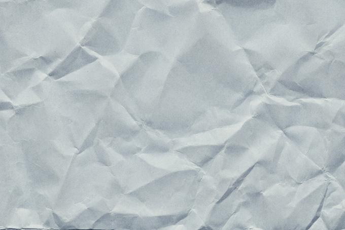グレーの厚手紙のシワ