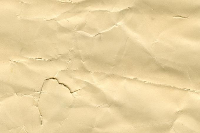 傷ついた茶色い紙のテクスチャ