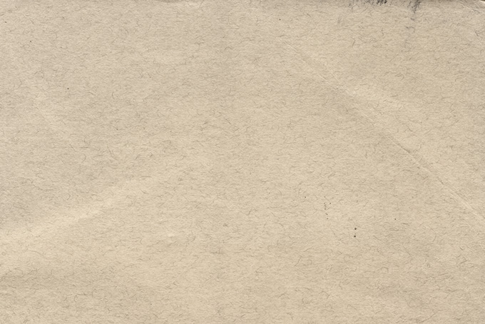 繊維が散りばめられた紙の写真(紙 テクスチャのフリー画像)