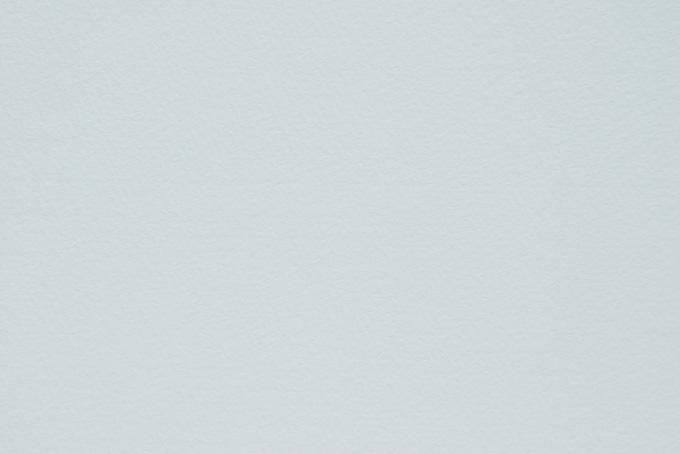 灰色の滑らかなテクスチャの紙