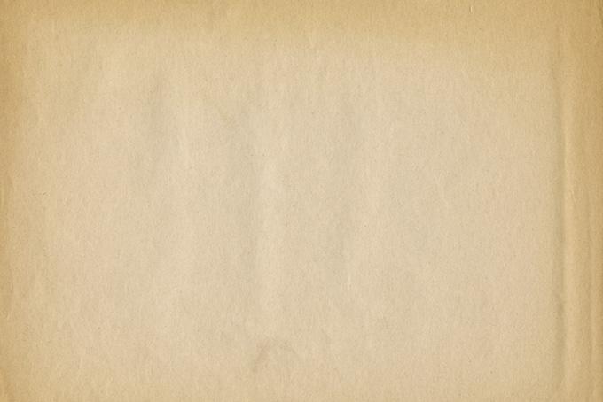 縁が焼けた茶色く古い紙の背景(紙 テクスチャのフリー画像)