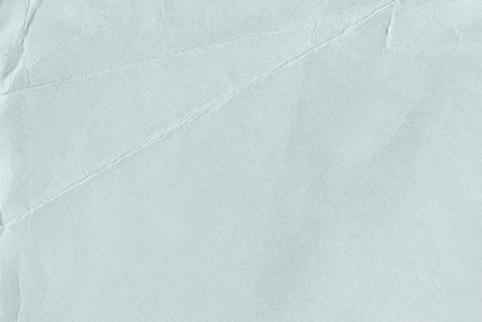 折れ目のあるザラザラとした紙の背景(紙 テクスチャのフリー画像)