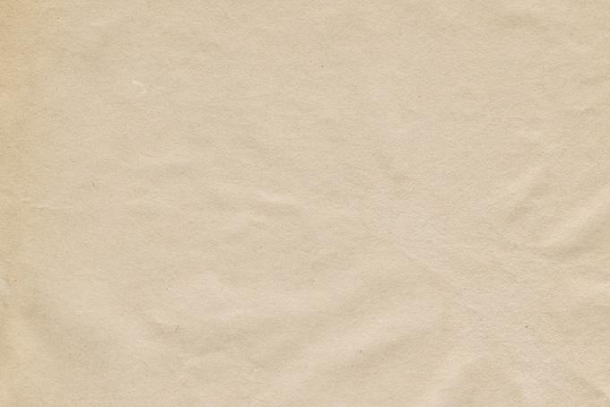 素朴な雰囲気の生成り色の紙の画像(紙 テクスチャのフリー画像)