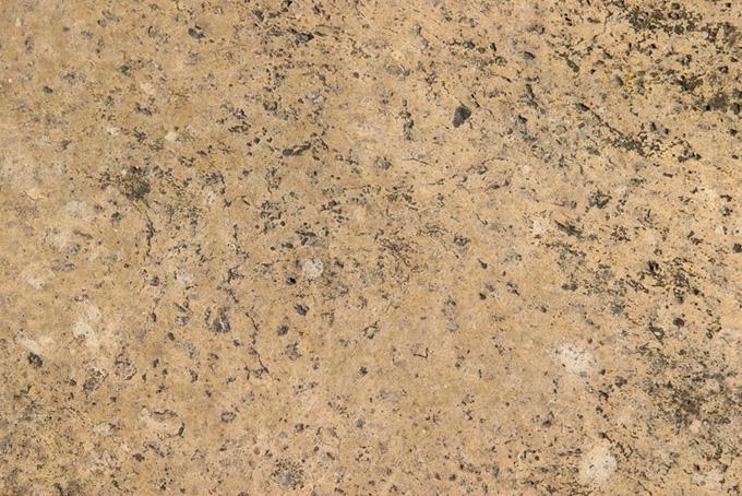 薄き色の乾いた石のテクスチャ