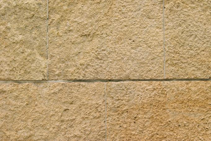 薄茶色の石壁のテクスチャ