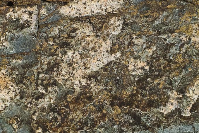 斑な模様の岩のテクスチャ