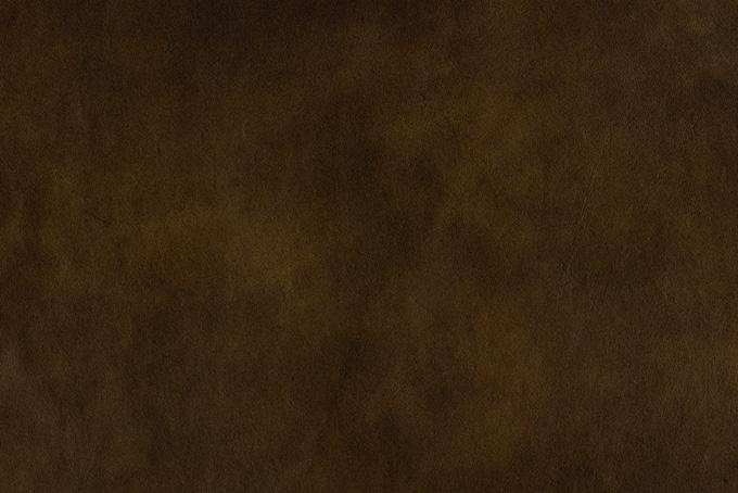 焦げ茶色の皮のテクスチャ