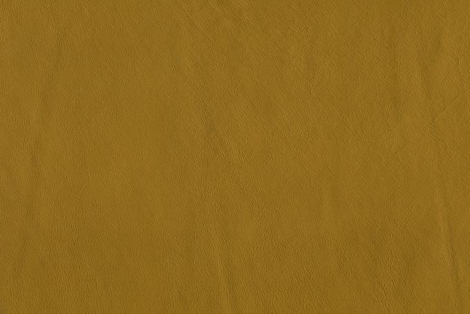 黄系の牛革のテクスチャ