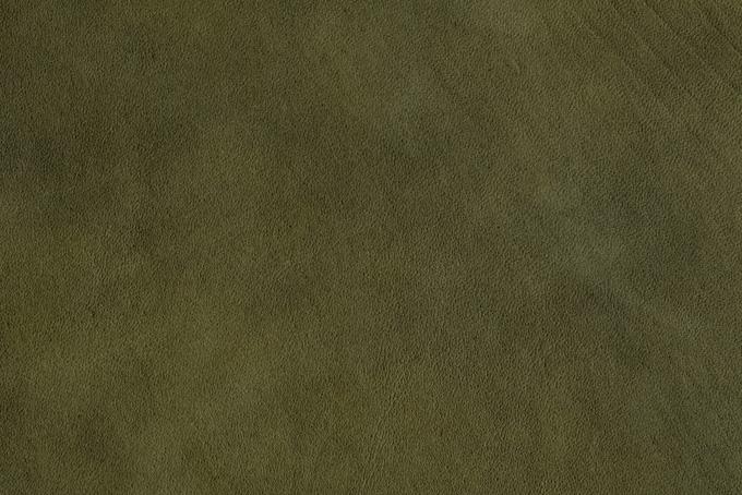 モスグリーンの革のテクスチャ