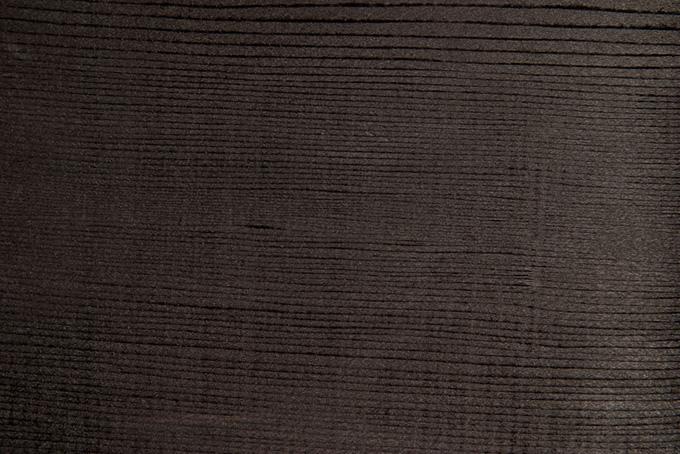 乾燥した黒い板の木目のテクスチャの背景