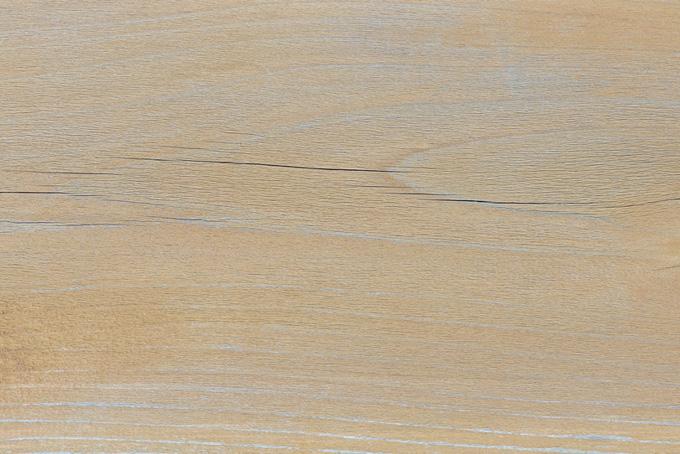 ひび割れた板の表面のテクスチャの背景